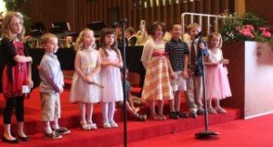 children particpating in a FBC church service